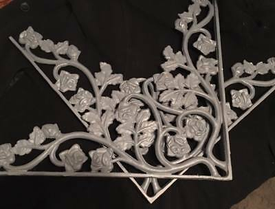 Two Large Antique cast Iron decorative corner brackets, flowers and leaves