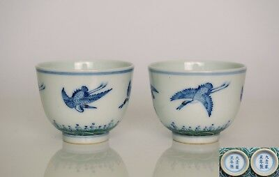 A Pair of Doucai 'Crane' Cups, Six-characters mark