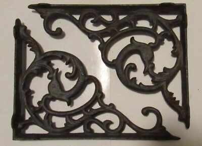 Pair of vintage cast wall brackets with a  Dolphin within the design