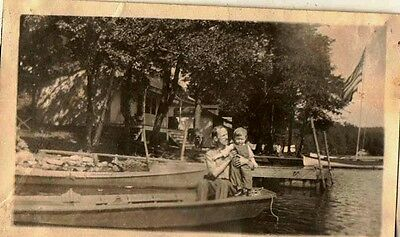 Old Antique Vintage Photograph Man Holding Little Boy in Boat on Lake