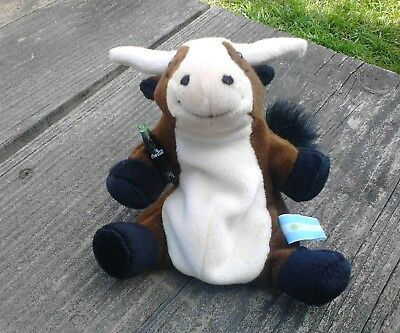 a plush toy bull with Coca-Cola bottle