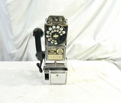 1957 – 1972 Chrome Automatic Electric Payphone