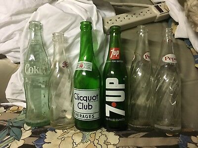 Lot of six vintage soda pop bottles:Coca-Cola,Pepsi,7-up,and Clicquot club