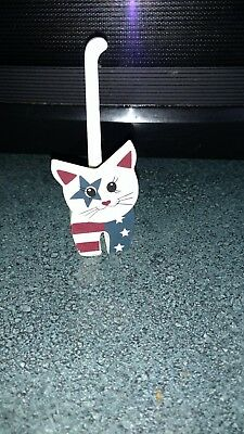 red/white/blue cat figure wooden