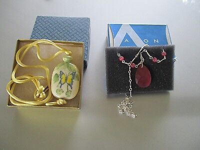 Avons Cat's Eye (pink) & a hand painted porcelain butterfly pendant necklaces