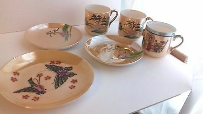 Porcelain.Stunning Japanese Hand Painted cup and saucer Klimax studio