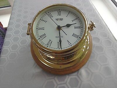 Reproduction brass ships quartz  clock by Moores on wood base