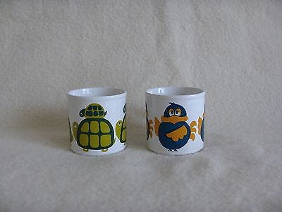 Pair of Staffordshire contemporary-style children's mugs bird and turtle
