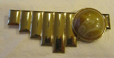 Vintage gold tone modernist brooch with beige acrylic