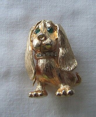 Vintage gold tone basset hound dog brooch with green rhinestones