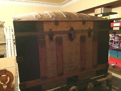 Dome Top Trunk/ Steamer Chest With Pretty Metalwork Covering Wood