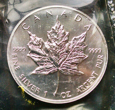 Canada:  1990 silver Maple Leaf ounce in original packaging