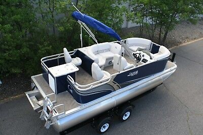 New -18 ft pontoon boat with four stroke 25 and trailer