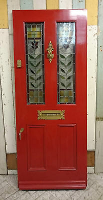 A DECORATIVE VICTORIAN OAK FRONT DOOR WITH ORIGINAL STAINED GLASS ref 970