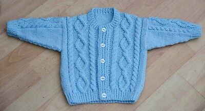 babies hand knitted aran style  cardigan age6 to 12 months in pale blue