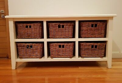 White sideboard with baskets