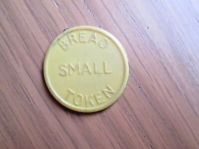 Co-op token  Chirk  & District  small loaf - light yellow plastic