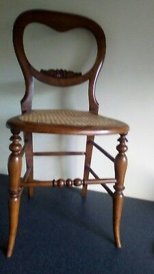Victorian balloon back chair with caned seat turned legs. Seat in good condition