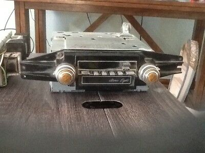 late 1960's cadillac car radio's, one with 8 track one without