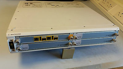 Agilent N2X 4 Module Main Frame & N5552A Router Test Card Fitted with  manuals