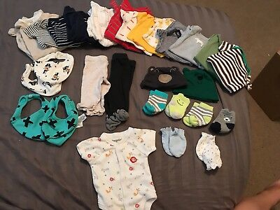 Newborn Clothing Lot 28 pieces with brand new bibs  and 20 pieces are carters