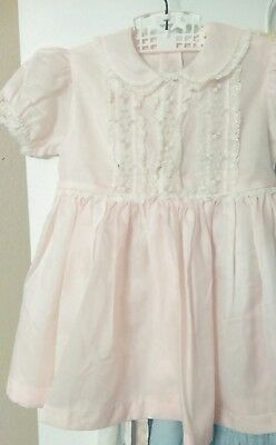 Vintage little girls pink dress from 1950's