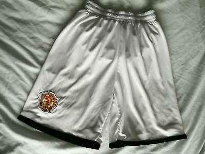 Manchester United football shorts size 4 white with black trim