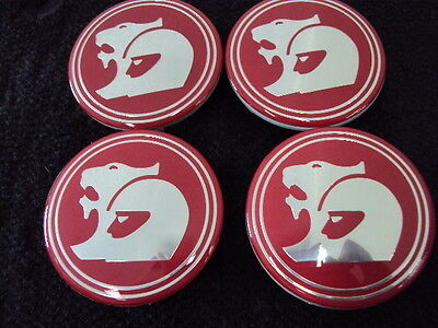 HSV CENTRE CAPS IN RED,  SET OF 4  63mm commodore holden