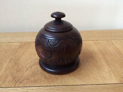 wooden pot ornament with animal carved decoration