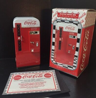 """1994 Coca Cola Enesco Metal Collectible Musical Bank  """" It's The Real Thing """""""