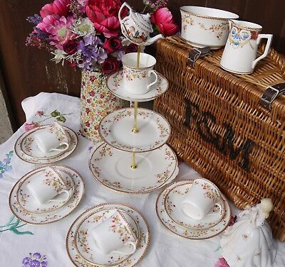 Vintage pretty mad hatter tea set & cake stand with 4 trios