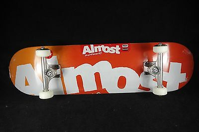 Almost Complete Skateboard SAF Titanium Trucks Side Pipe Red 8.25 Grizzly Manton