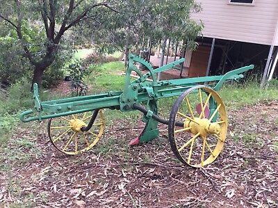 Antique Ransomes double farrow digging plough brightly restored.