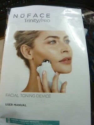 NuFace Trinity PRO Facial Toning & Training Device in clear travel case