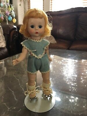 Vintage Madame Alexander kins walker With Skates
