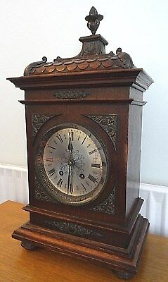 Lenzkirch Oak Cased 8 Day Striking Bracket Clock.