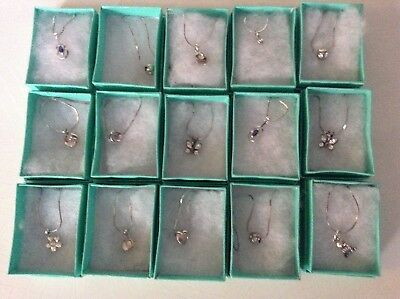 Wholesale joblot of 15 boxed assorted new silver tone necklaces