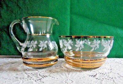 Milk Jug and Sugar Bowl Clear Glass Piped with Gold Decorated With White Leaves
