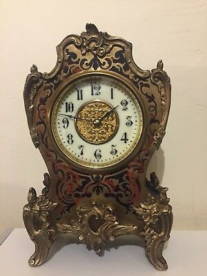 Small French Black And Red Boulle Clock With Brass Inlay.
