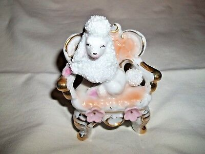Vintage spaghetti/sugar poodle figurine sitting in chair Very Good condition
