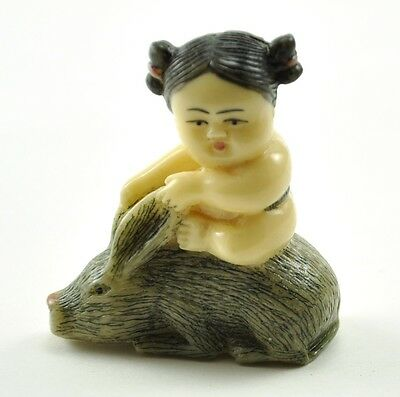 Old Chinese/ Japanese Happy Lucky Baby Girl ride Bunny Rabbit Resin NETSUKE 1.7""