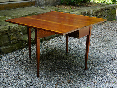 Original Antique New England cherry drop leaf table with swing legs, table c1810