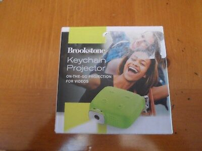 New in Box ! Brookstone Keychain Mini Portable Projector green