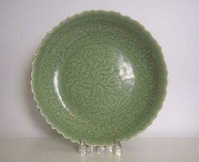 A Fine and Rare Large Celadon Glazed Carved 'Loquats' Charger
