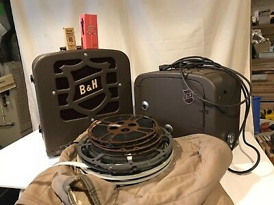 Bell and Howell B & H Filmosound 185 16MM Projector with Speaker and Movies
