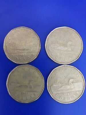 Canadian one dollar coins - lot of 4