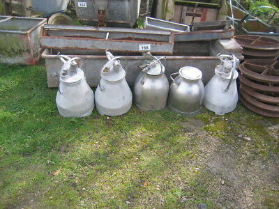 Selection of Milk Churns and carrying buckets