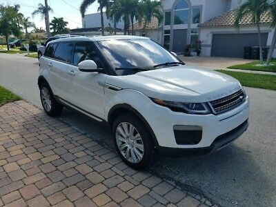 2016 Land Rover Evoque HSE 4X4 2016 Land Rover Evoque HSE 4X4 White Over Black. Panorama Roof. All Options.