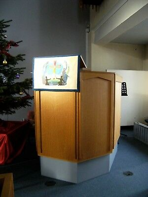 Wooden church pulpit in good condition. Blue base. Reading Lectern attached.