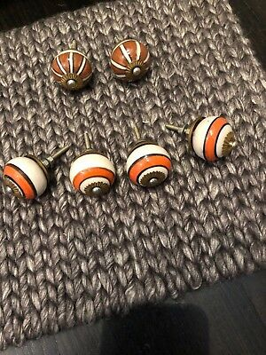 Vintage enamel and brass drawer pulls 4 with orange, 2 with brown. Excellent